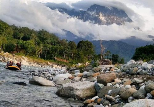 Mount Kinabalu view in background when rafting
